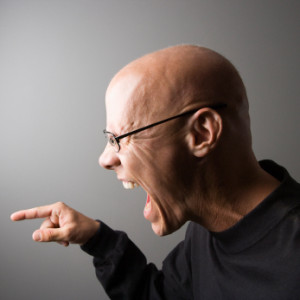 Profile of man screaming.