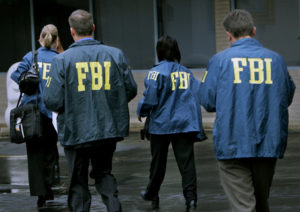 FBI agents leave the office of Cuyahoga Metropolitan Housing Authority headquarters Wednesday, October 15, 2008. Law enforcement agents raided the home and office of George Phillips, executive director of CMHA. (Gus Chan / The Plain Dealer)